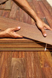 Ipe deck installation carpenter hands holding wood Royalty Free Stock Photos