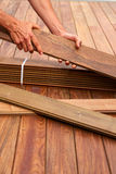 Ipe deck installation carpenter hands holding wood Royalty Free Stock Photography