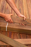 Ipe deck installation carpenter hands holding wood Stock Photography