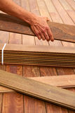 Ipe deck installation carpenter hands holding wood Royalty Free Stock Images
