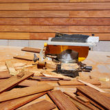 Ipe wood fence installation carpenter table saw Royalty Free Stock Photo