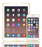 Iphoe 6 and IPad air 2 gold. Apple Iphoe 6 and IPad air 2 with icon on screen reality illustration stock illustration