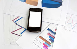 Iphon. place on sheet graph and chart for report work Royalty Free Stock Image