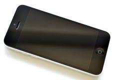 IPhone της Apple στο άσπρο υπόβαθρο, Στοκ Φωτογραφία