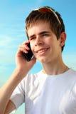 青少年与iPhone 图库摄影