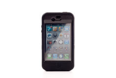 iPhone 4 d'Apple dans Otterbox Photos libres de droits