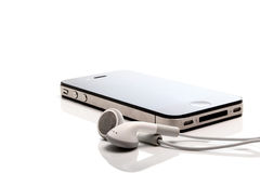 Iphone 4S and earphones. On white background Stock Photo