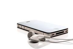 Iphone 4S and earphones stock photo