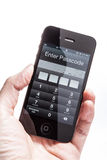Iphone 4S enter the password to unlock royalty free stock photo