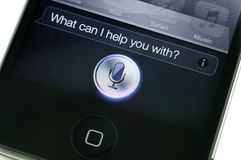 iPhone 4s Siri d'Apple Images libres de droits
