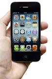 Iphone 4s w ręce Zdjęcia Royalty Free
