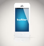 Iphone 5 device, showing the Twitter logo. Stock Photo