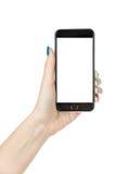 Женщина показывая iphone с изолированным экраном стоковые изображения