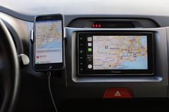 IPhone with Apple Maps on the screen and Car Play Royalty Free Stock Photography