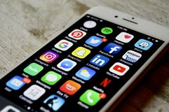 iPhone with assortment of apps displayed royalty free stock photography