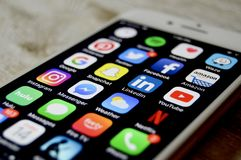 iPhone with assortment of apps displayed royalty free stock photo