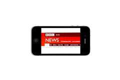 IPhone and BBC NEWS. BBC NEWS website displayed on iPhone screen Stock Photography