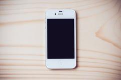 IPhone blanco 4s de Apple Fotos de archivo