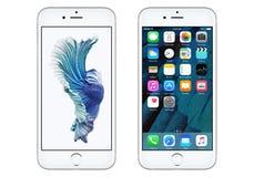 IPhone blanco 6S de Apple con IOS 9 y el papel pintado dinámico Imagen de archivo
