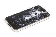 IPhone 4 com a tela de exposição seriamente quebrada da retina Foto de Stock Royalty Free