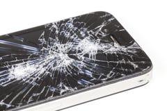 IPhone 4 con la pantalla de visualización seriamente quebrada de la retina foto de archivo