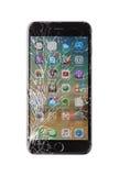 Iphone dañado en el fondo blanco Fotos de archivo
