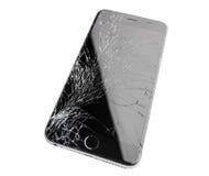 Iphone dañado en el fondo blanco Fotos de archivo libres de regalías