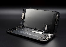 IPhone de Apple 7 componentes mostrando desmontados para dentro imagens de stock