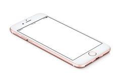 IPhone de Rose Gold Apple 7 mentiras do modelo na superfície com a tela vazia branca foto de stock