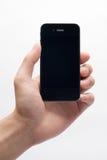 Iphone della holding della mano Fotografia Stock Libera da Diritti