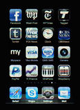 Iphone display with collection of apps. Muenster, Germany, April 16, 2011: Image of the iphone touch screen. Display shows a collection of useful apps with blue Royalty Free Stock Images