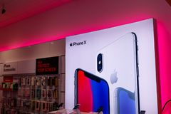 Dayton - Circa April 2018: iPhone X display at a T-Mobile wireless store. T-Mobile upgraded hundreds more cell sites with LTE IV. IPhone X display at a T-Mobile Royalty Free Stock Photos