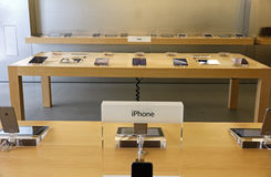 IPhone displayed in an apple store. IPhone  displayed on a table in an apple store Royalty Free Stock Photo