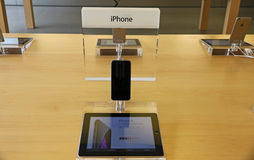 IPhone displayed in an apple store. IPhone  displayed on a table in an apple store Stock Image