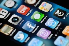 iphone för 4 apps Fotografering för Bildbyråer