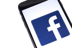 IPhone and Facebook logo stock image