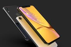3 iPhone Gelbe, silberne und des Raumes graue intelligente Telefone XR auf Schwarzem