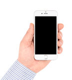 IPhone 6 in hand on white background turned off. Stock Image