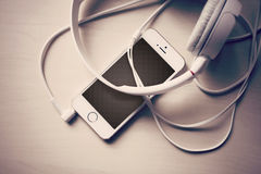 IPhone and Headphones. An IPhone plugged into hHeadphones Stock Image