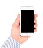 IPhone 6 i hand på vit bakgrund vände av Fotografering för Bildbyråer