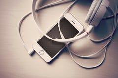 IPhone i hełmofony Obraz Stock