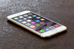 IPhone 6. Koszalin, Poland – July 06, 2015: Golden iPhone 6. Devices displaying the applications on the home screen. The iPhone 6 is smart phone with multi Stock Photos