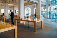 IPhone Mobile Phones and iPad Tablets For Sale in Apple Store. AMSTERDAM, NETHERLANDS - NOVEMBER 13, 2017: iPhone Mobile Phones and iPad Tablets For Sale in Royalty Free Stock Photography