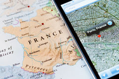 Iphone with navigation application on map of Paris, France Royalty Free Stock Images