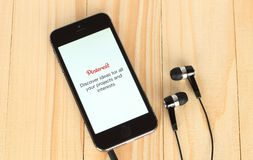 IPhone with Pinterest logotype on its screen and headphones Royalty Free Stock Photos