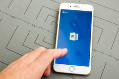 IPhone 7 plus and Microsoft Word app. PARIS, FRANCE - SEPT 26, 2016: New iPhone 7 Plus with hand touching screen to make a new Microsoft Word document on mobile Royalty Free Stock Photo