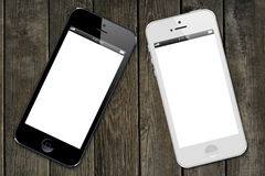Iphone 5s. Black and white iPhone 5s models showing a blank white screen. On wooden texture Editorial use only Vector Illustration