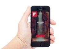 IPhone 5s con Flipboard app Fotografía de archivo