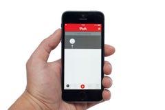 IPhone 5S con la trayectoria app Fotos de archivo libres de regalías