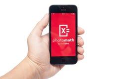 IPhone 5s con PhotoMath app Foto de archivo